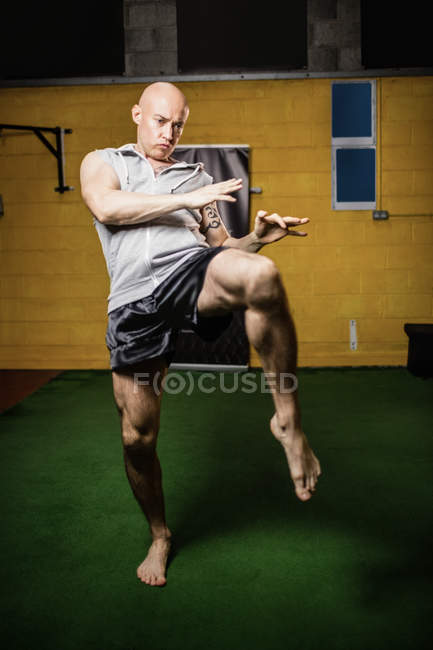Handsome Thai fighter practicing boxing in gym — Stock Photo