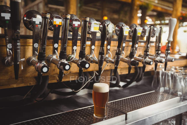 Close-up of beer pump in a row at bar — Stock Photo