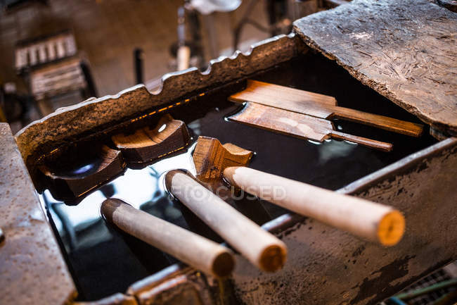 Close-up of glassblowing block in glassblowing factory with instruments — Stock Photo
