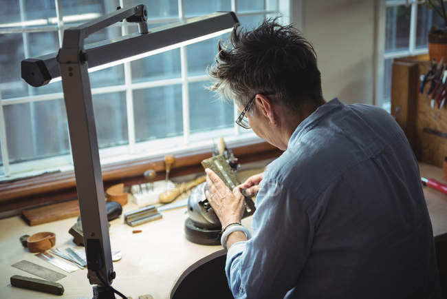 Attentive craftswoman working in workshop — Stock Photo