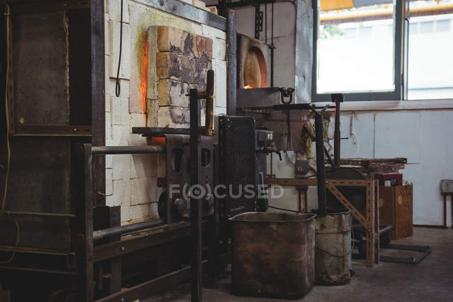 Empty workstation and furnace at glassblowing factory — Stock Photo