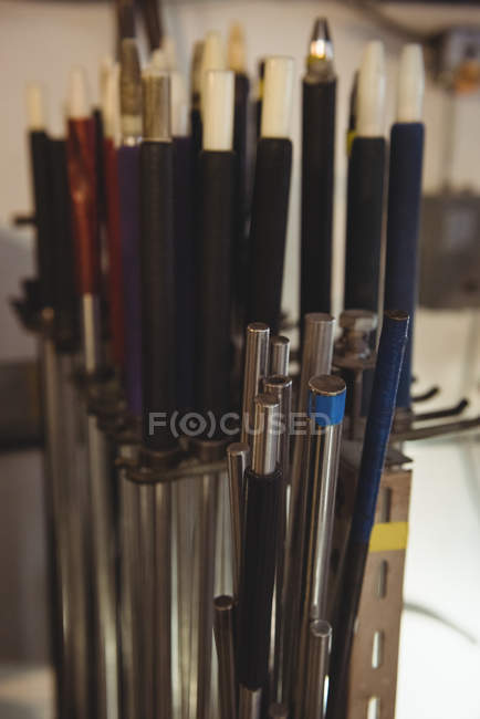 Close-up of various types of blowpipes at glassblowing factory — Stock Photo