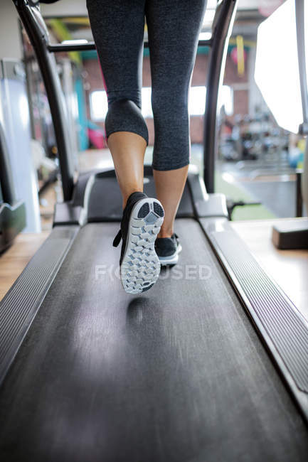 Woman exercising on treadmill at gym — Stock Photo
