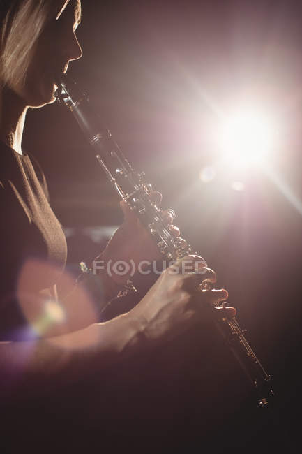 Woman playing a clarinet in music school — Stock Photo