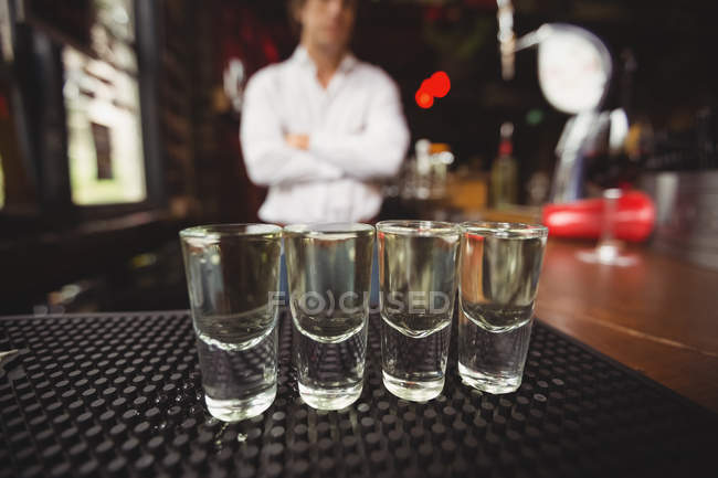 Close-up of tequila in shot glasses on bar counter at bar — Stock Photo