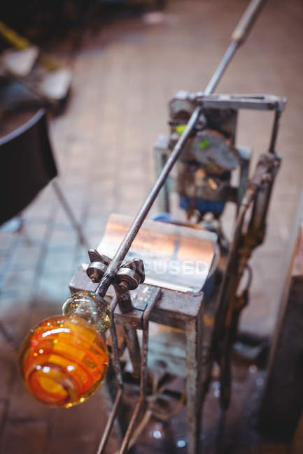 Close-up of orange glass being molded in studio — Stock Photo