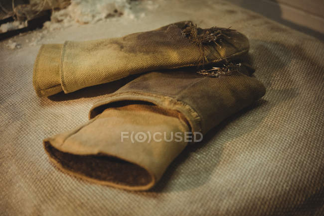 Close-up of glassblowing gloves at glassblowing factory — Stock Photo