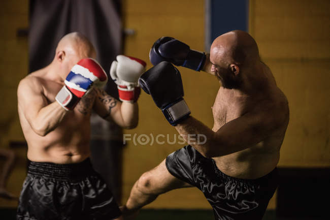 Side view of two thai boxers fighting in gym — Stock Photo