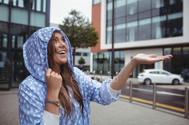 Beautiful wet woman enjoying rain during rainy season — Stock Photo