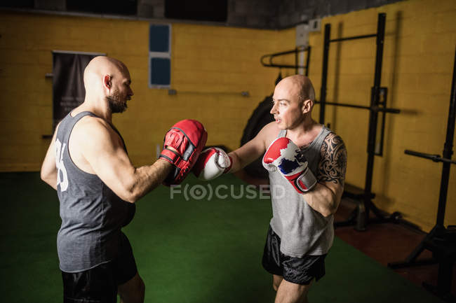 Two thai boxers practicing boxing in gym — Stock Photo