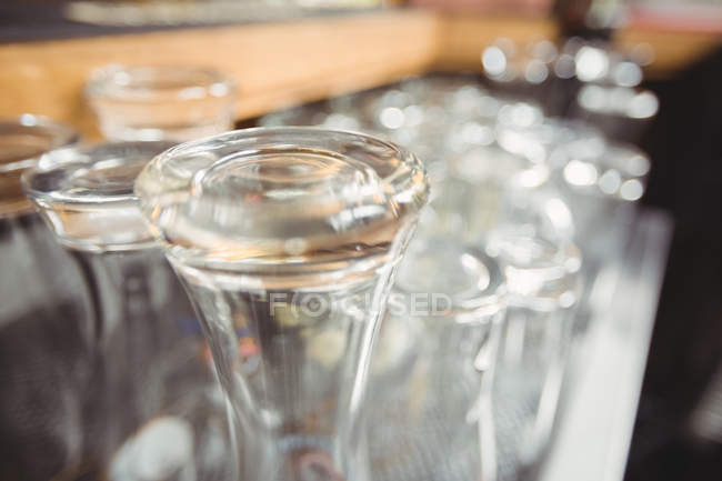 Close-up of various glasses at bar counter — Stock Photo
