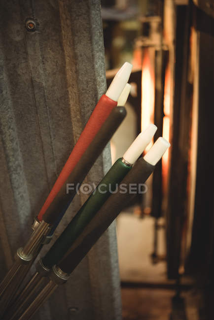 Close-up of blowpipes at glassblowing factory — Stock Photo