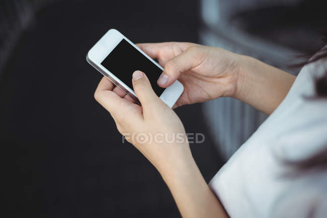 Close-up of woman text messaging on mobile phone — Stock Photo
