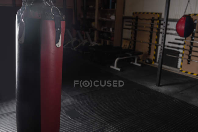 Punching bag for boxing or kick boxing sport in fitness studio — Stock Photo