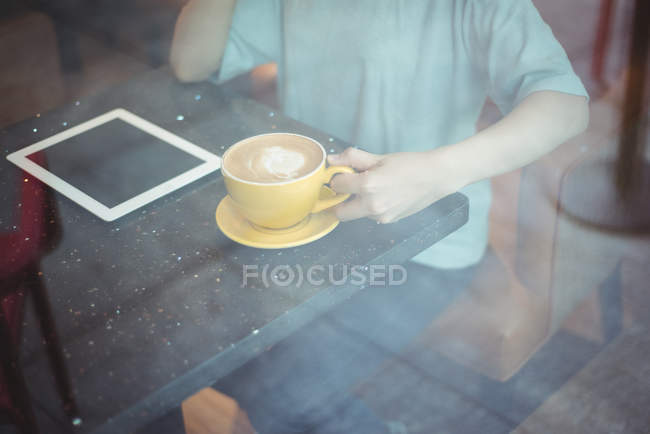 Woman having coffee at cafe — Stock Photo