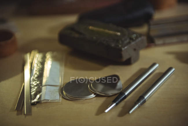 Close-up of various crafts maker equipment's on workbench — Stock Photo