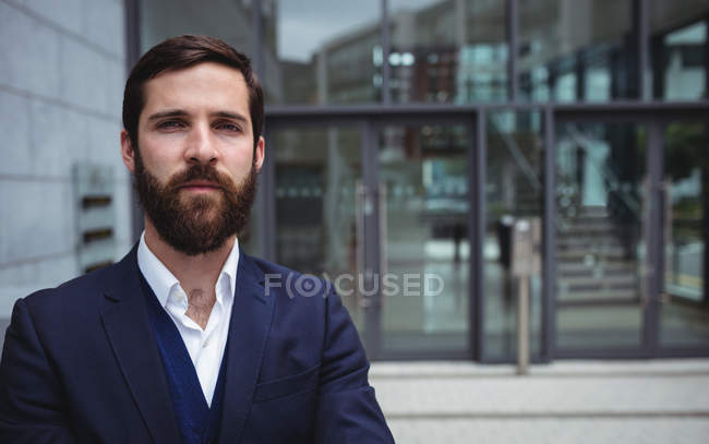 Portrait of businessman standing outside office — Stock Photo