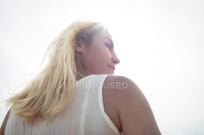 Low angle view of a carefree blonde woman on sunny day — Stock Photo