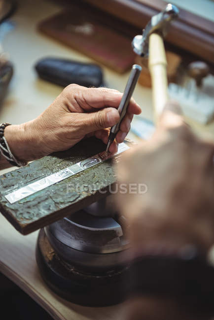 Hands of craftswoman using tools in workshop — Stock Photo