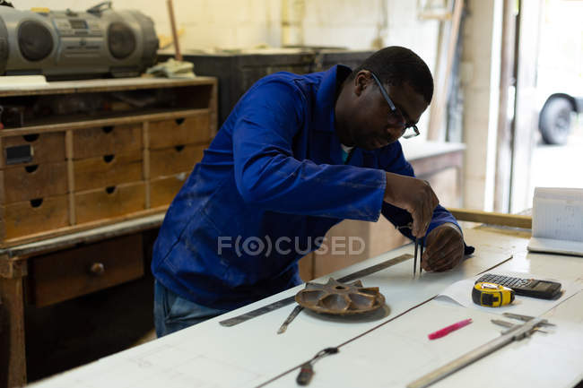 Attentive worker working in foundry workshop — Stock Photo