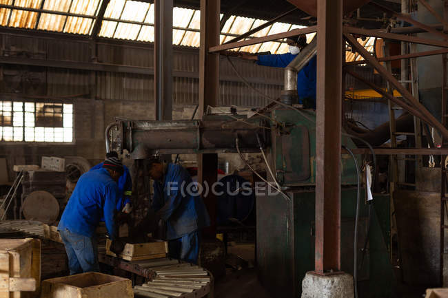 Male workers in foundry working with molds — Stock Photo