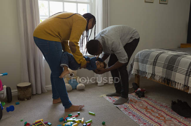 Father, mother and son playing in a living room at home — Stock Photo
