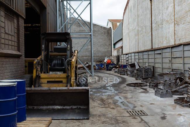Modern bulldozer near foundry workshop — Stock Photo