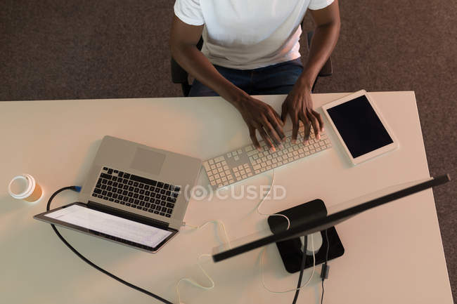 High angle view of business executive working at desk in office — Stock Photo