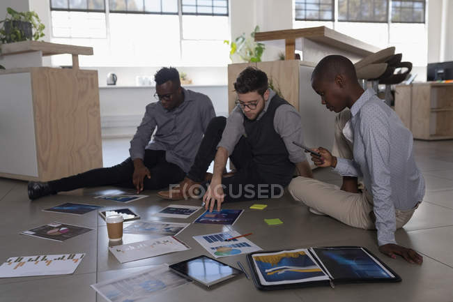 Attentive executives working on office floor — Stock Photo