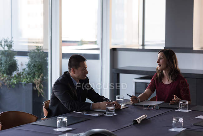 Business people talking with each other in conference room at hotel — Stock Photo