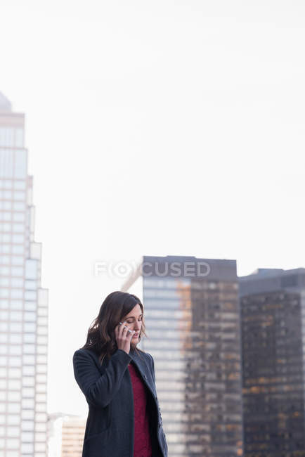 Businesswoman talking on mobile phone in balcony at hotel — Stock Photo