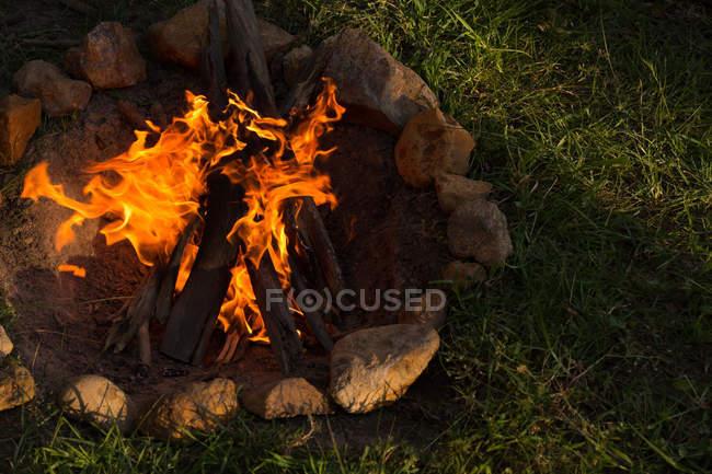 Close-up of bonfire at campsite — Stock Photo