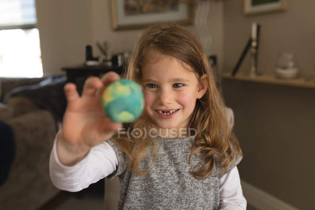 Happy girl playing with toy at home — Stock Photo