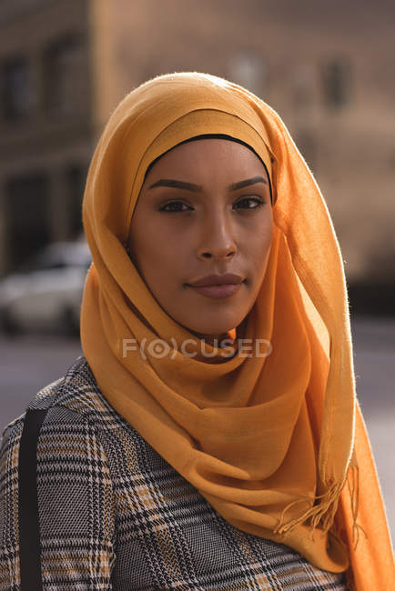 Portrait of hijab woman looking at camera in city — Stock Photo