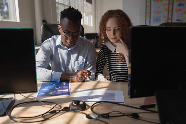 Multicultural Executives working at desk in office — Stock Photo