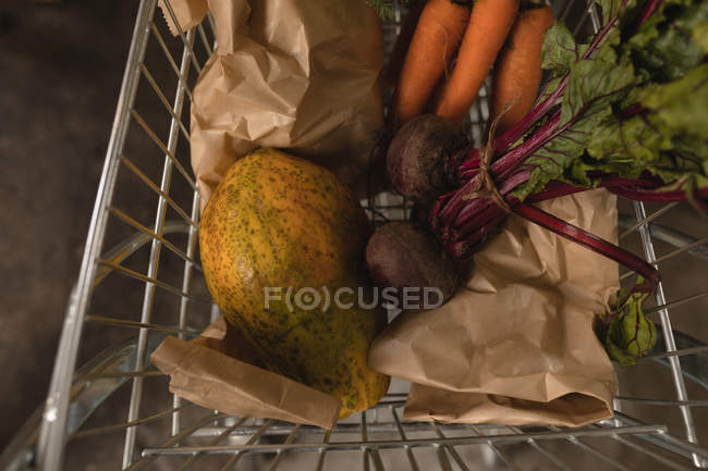 Close-up of vegetables in shopping trolley at supermarket — Stock Photo