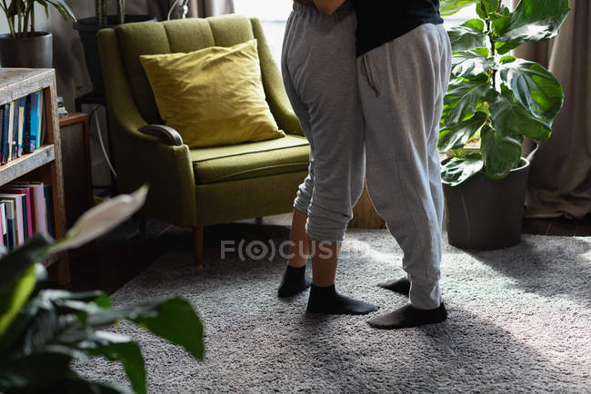 Low section of couple embracing each other at home — Stock Photo