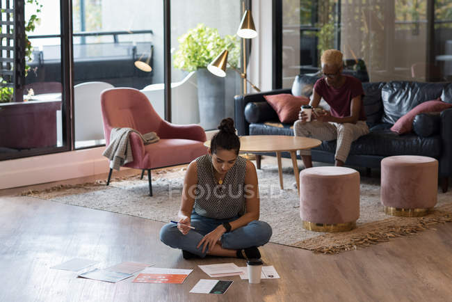 Attentive businesswoman working in office — Stock Photo