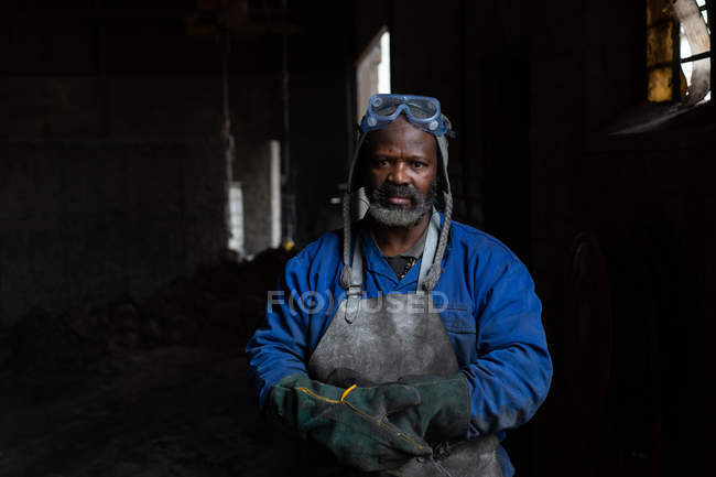 Portrait of male worker standing in foundry — Stock Photo