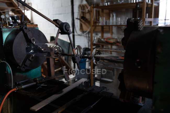 Close-up of machine in glass factory — Stock Photo