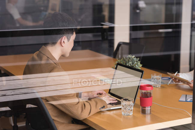 Attentive executive using laptop in office — Stock Photo