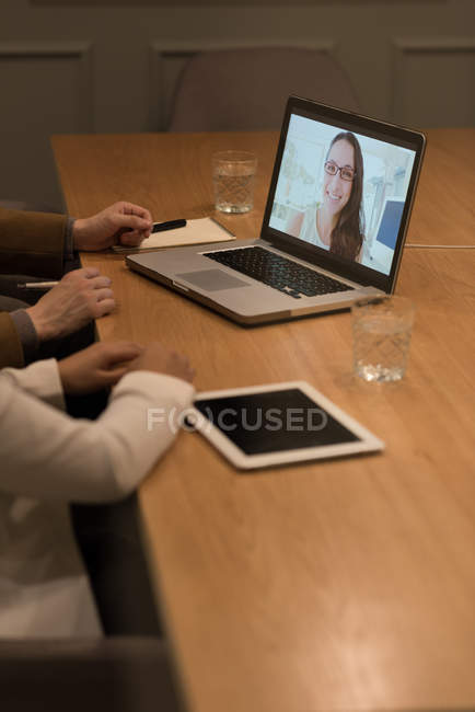 Business executives doing a video conference on laptop in office — Stock Photo