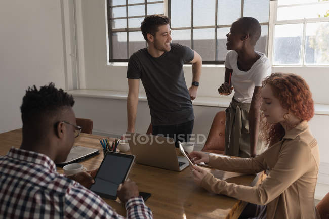 Executives working in conference room at office — Stock Photo