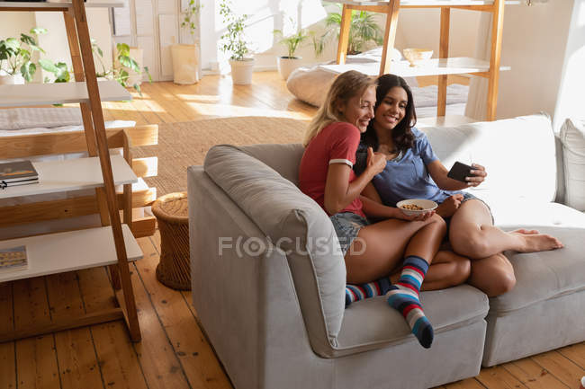 High view angle of female women taking selfie at home in living room — Stock Photo