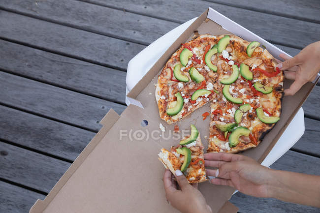 High view angle of friends enjoying pizza party — Stock Photo