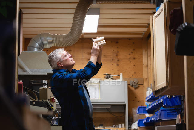 Side view of caucasian carpenter working at a workshop — Stock Photo