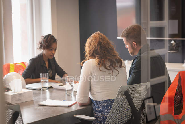 Side view of diverse business people planning in conference room meeting at office — Stock Photo