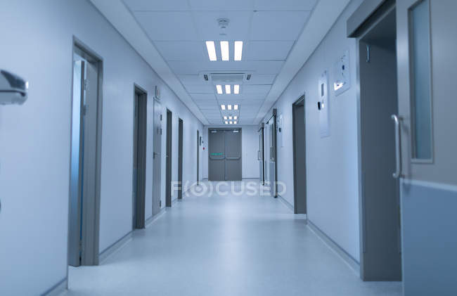 Front view of an empty modern corridor of hospital. — Stock Photo