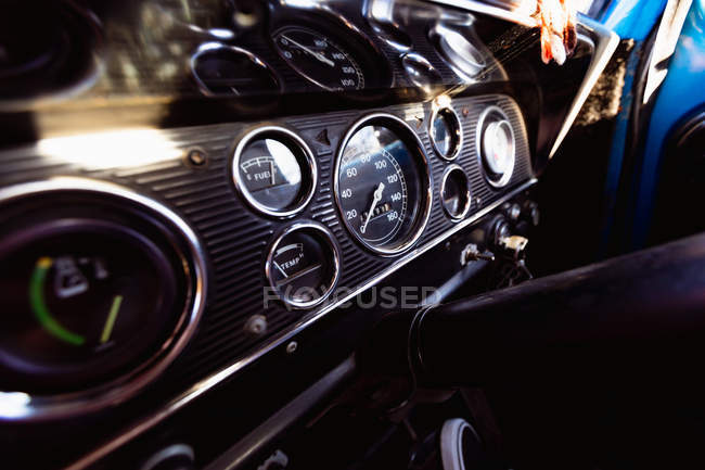 Close up of the dashboard of a pick-up truck in the sunlight, with the key in the ignition — Stock Photo