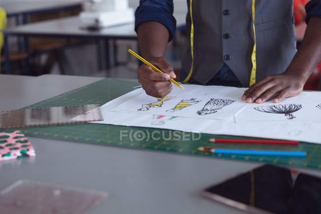 Front view mid section of male fashion student working on a design in a studio at fashion college — Stock Photo